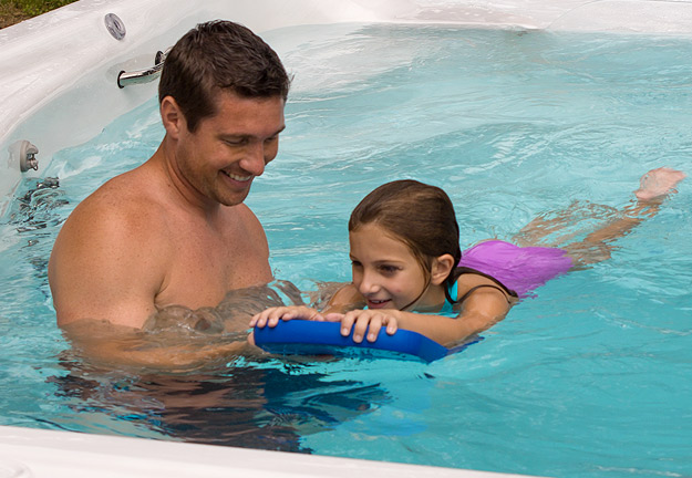 Father and daughter enjoying a Michael Phelps Swim Spa